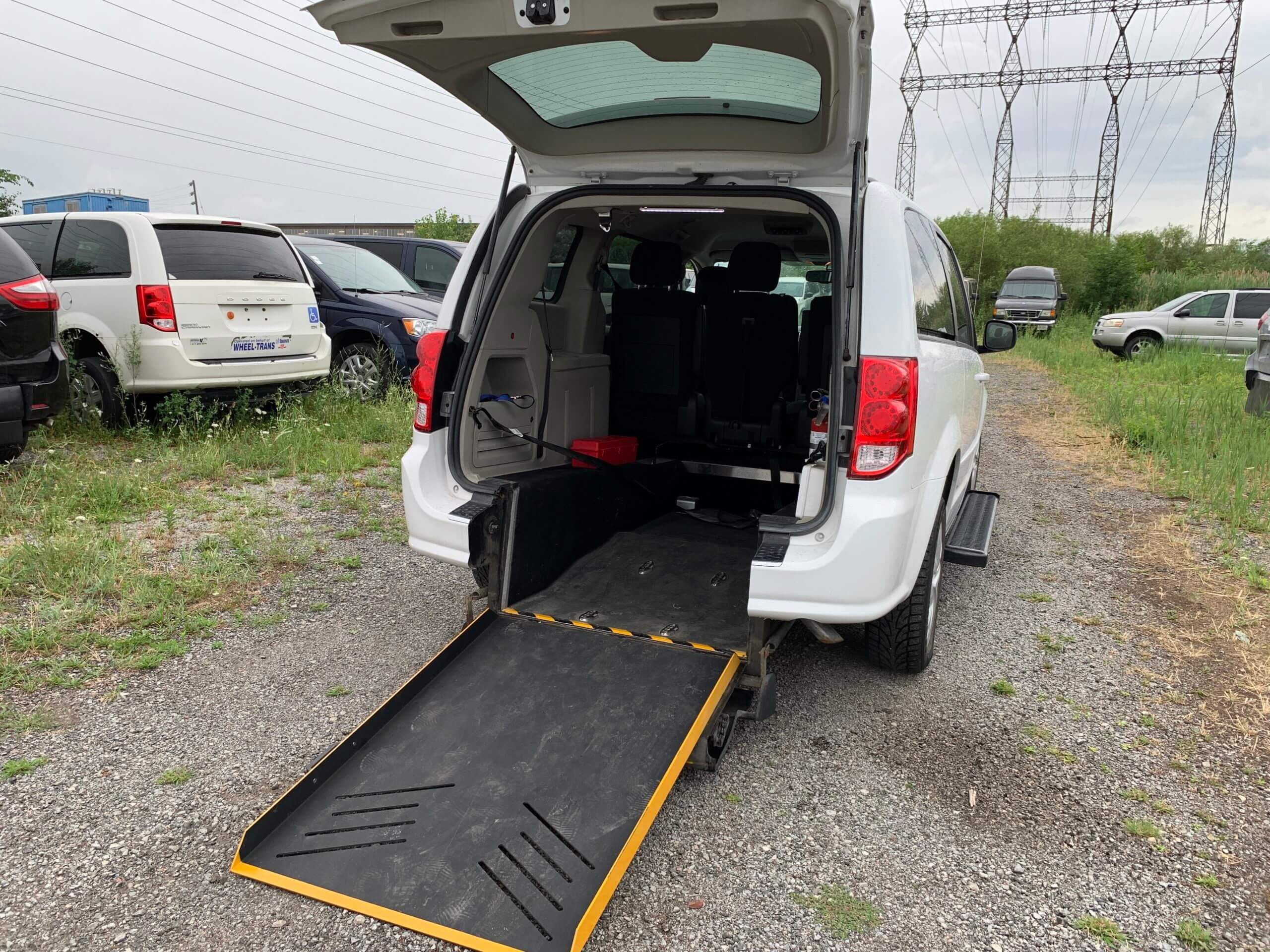 Exterior rear ramp opened view of 2015 Dodge Grand Caravan SXT