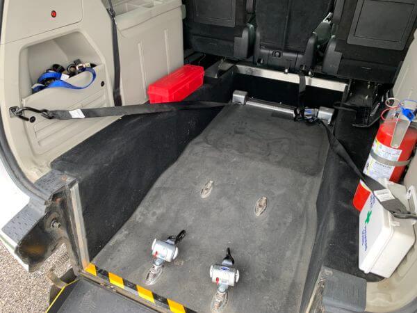 Close up interior rear wheelchair space of 2015 Dodge Grand Caravan SXT