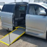 Exterior side ramp out view of 2020 Toyota Sienna LE