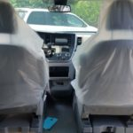 Interior facing driver and passenger seat view of 2020 Toyota Sienna LE