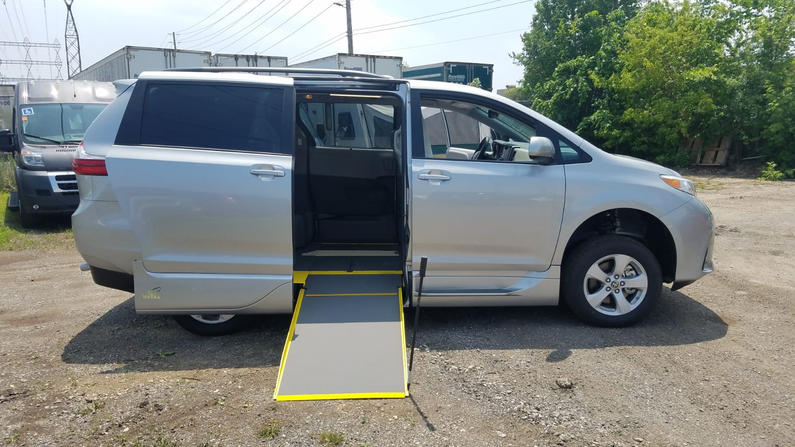 Second exterior side ramp out view of 2020 Toyota Sienna LE