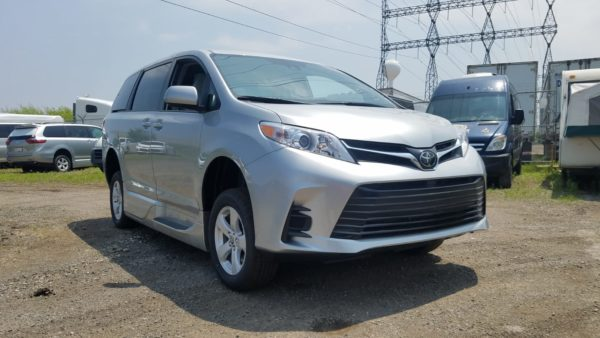 Exterior angled front side view of 2020 Toyota Sienna LE