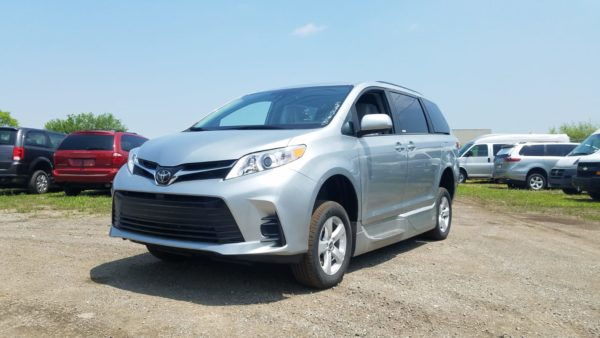 Exterior angled front side driver side view of 2020 Toyota Sienna LE