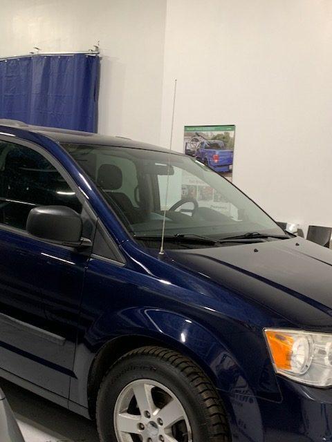 Exterior front side view of 2013 Dodge Grand Caravan