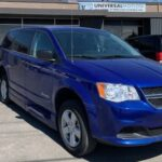 Exterior right side angle view of 2019 Dodge Grand Caravan SE+