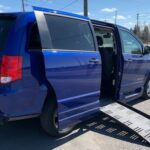 Second angle of exterior view of ramp opened up of 2019 Dodge Grand Caravan SE+