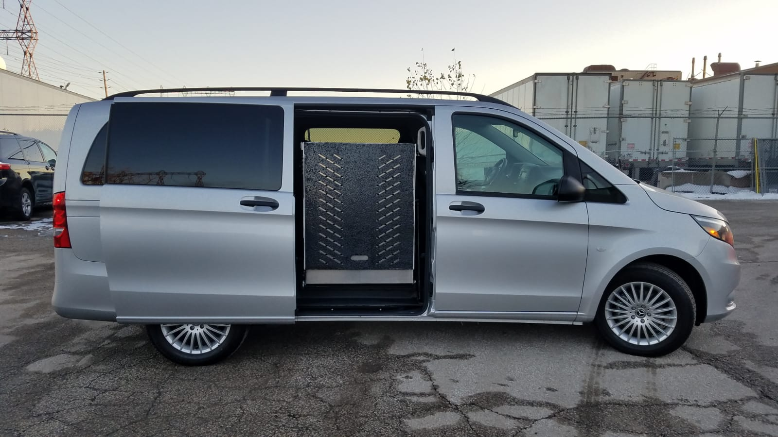Exterior view of side ramp in folded up position of 2020 Mercedes Metris